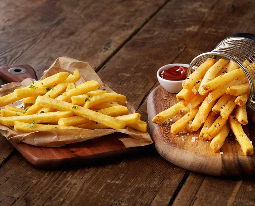 Mccain french fries on wooden serving board
