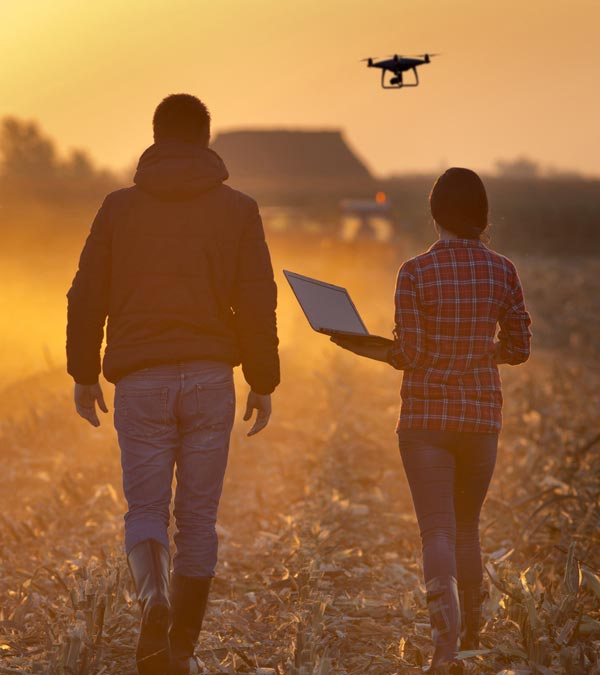 People-stood-in-farming-field-with-drone-header-mobile.jpg